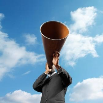 Man Holding Loudspeaker --- Image by © Royalty-Free/Corbis